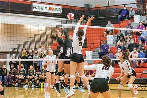The Ronan Maidens and the Polson Lady Pirates battle at the net. The Maidens prevailed over the Lady Pirates in four sets.