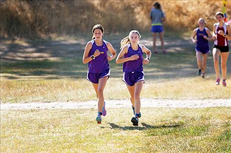 Two Lady Pirate runners race toward the finish line.