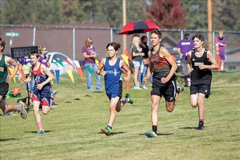 Bulldog Zoran LaFrombois and Chief Zarec Couture run in the Mission Shadows cross country meet.