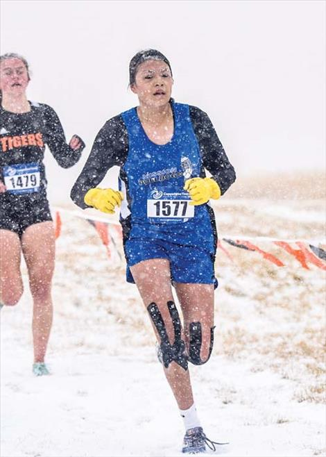 Mission Lady Bulldog Cedar Hunt battles the snowy elements.