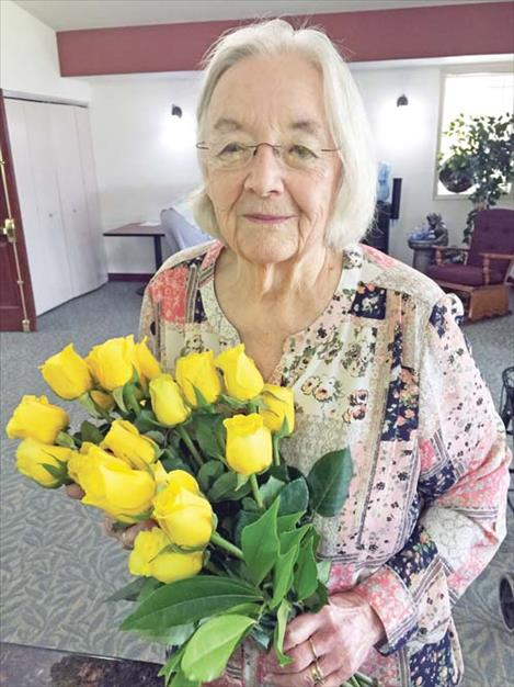 Maureen Theiler celebrates her 82nd birthday last April with yellow roses.