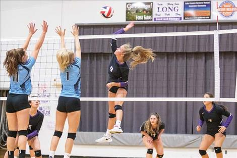Lady Viking Carlee Fryberger battles at the net.