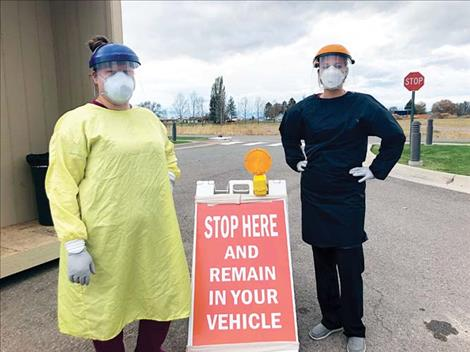 Tanisha Matt and Leona Spittler were poised to conduct curbside COVID-19 tests in the parking lot at St. Luke Hospital in Ronan last week.
