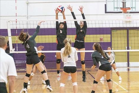 The Charlo Lady Vikings battle at the net during Western C divisional action