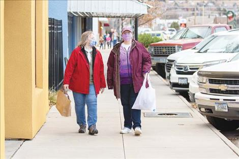 The sidewalk along Main Street in Polson was bustling with shoppers during the Small Business Saturday event.