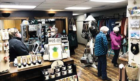 Krista Denning visits with customers at Sweet Home Montana Designs.