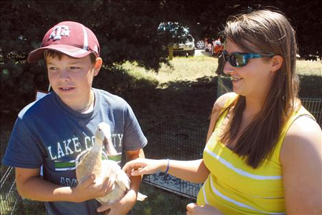 Monica with 4-H youth Phillip Vaughan and his project duck.