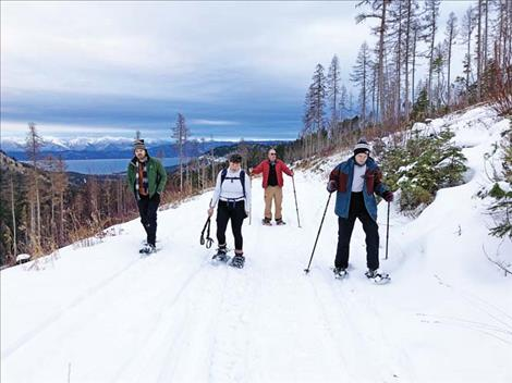 Snow-shoeing offers an alternative for exploring the winter landscape for the Moll and Cadigan families.