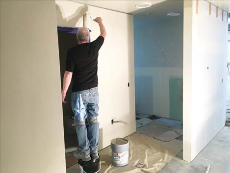 A painter applies the first coat of paint.