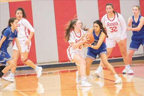 Arlee Scarlet Xaria Jacobson battles Mission Lady Bulldog Kooper Page for the ball.