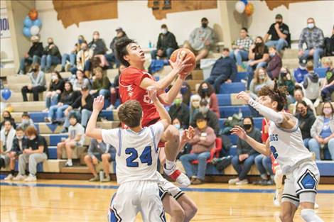 Arlee Warrior Levi Fullerton glides to the hoop for a score.