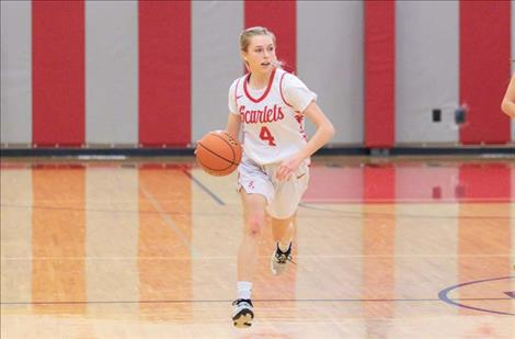 Arlee Scarlet Raven Parson searches down court for an open teammate.