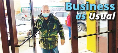 Robert Davis heads in to Mission Mountain Natural Foods on Main Street Monday morning. After the resort tax failed to pass during the election, Polson shopping will stay the same.