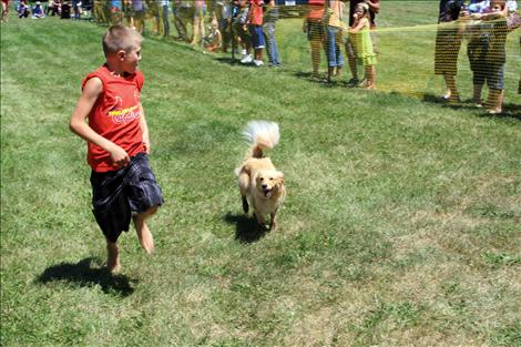 Dog races test the speed of man's best friend, with prizes for the fastest this weekend at Good Old Days in St. Ignatius.