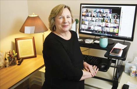 Mary Windecker, director of the Behavioral Health Alliance of Montana, works from her home office in Missoula on Feb. 9, 2021.
