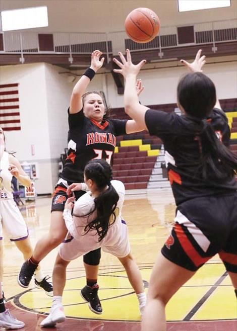 The Polson Lady Pirates and Ronan Maidens battle in the paint.