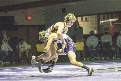 Polson Pirate Maysn Cowell and Ronan Chief Trevor Bartel battle in the 126 weight class.