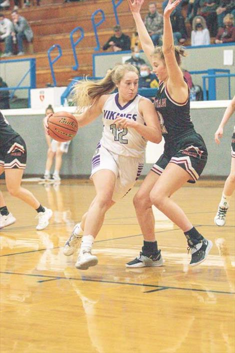 Charlo Lady Viking Liev Smith powers her way to the hoop during Western C Divisional Tournament action in Deer Lodge.