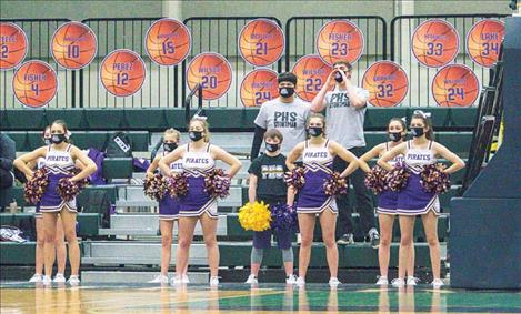 Polson High School cheerleaders support their team while maintaining COVID-19 precautions during the Western A Divisional basketball tournament, hosted at the Butte Civic Center on Friday.