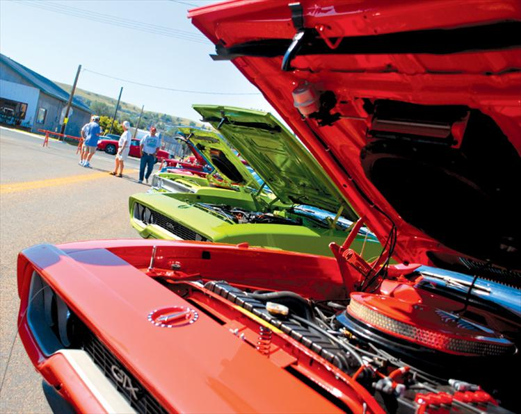 The Valley Cruisers' Cruisen By The Bay annual car show drew more than 1,000 participants and spectators to Polson. This row of Plymouth GTXs and Roadrunners was a magnet for fans of the cars .