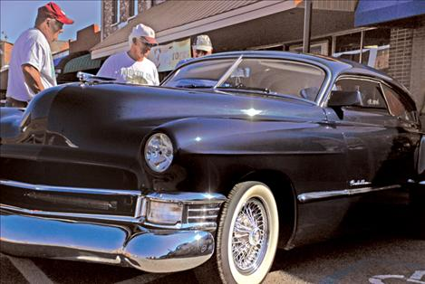 A 1948 Cadillac owned by Gary and Cathy Gatelli, Butte, drew curious spectators Saturday on Main Street.