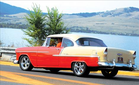 In their '55 Chevy, Tim and Sue Arneson drive across the Armed Forces Memorial Bridge during the cruise on Aug. 10.