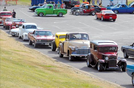 Classic cars line the parking lot at Riverside Park in Polson as drivers wait to cruise Rocky Point Road and Jette Hill.