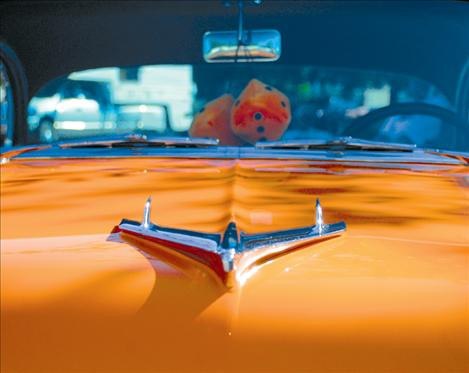 The hood ornament on Tim Arneson's '55 chevy shines in the sun.