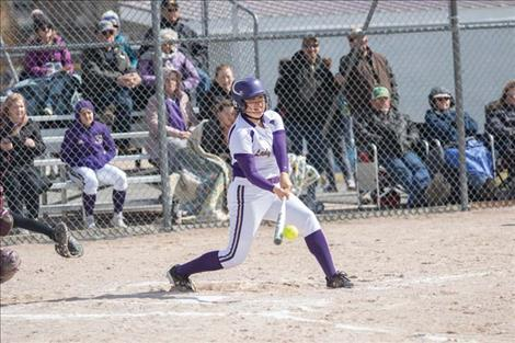 Polson Lady Pirate Mossy Kauley makes contact for a base hit.