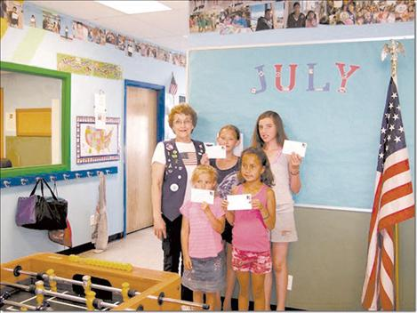 Winners of the VFW Ladies Auxiliary coloring contest are, left front, Kiana King; Eva Miller; Shanel Manuel and Tyariah Morigeau and Margaret Fay, Ladies' Auxiliary.