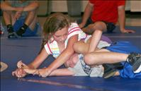 Kids wrestle with technique at Iron Dog camp