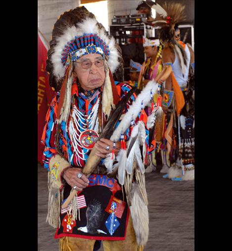 Frances Stanger wears his war bonnet to the Standing Arrow Powwow in Elmo.