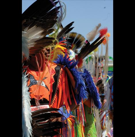 Dancers line up for the 1 p.m. Grand Entry at the Standing Arrow Powwow held at the Elmo powwow grounds.