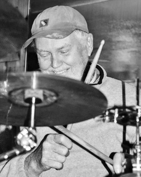 Red Poppy owner Don Burgess takes a turn at the drums during a recent Saturday night jam session.