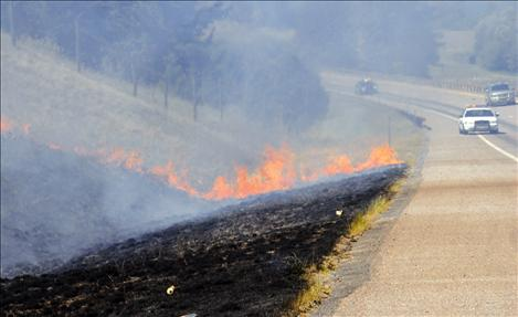 Polson volunteer firefighters responded to a report of a grass fire on Polson Hill Friday afternoon, and quickly doused the flames spreading through dry grass.