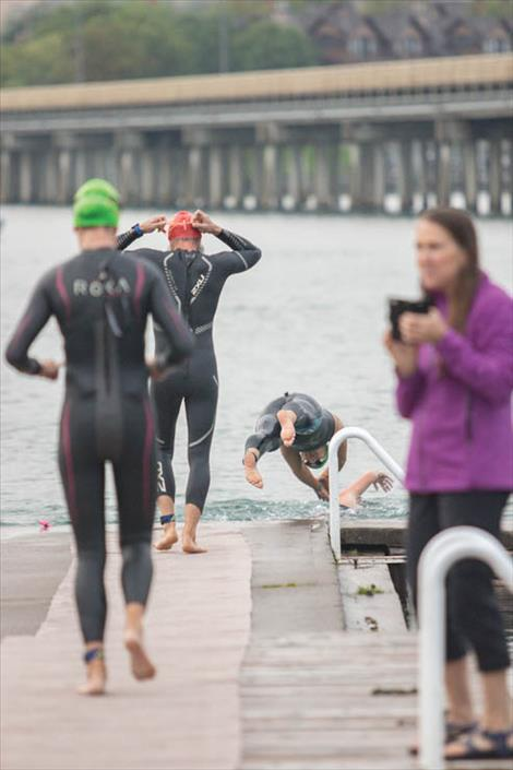 Swimmers make their way into the brisk waters of Flathead Lake.