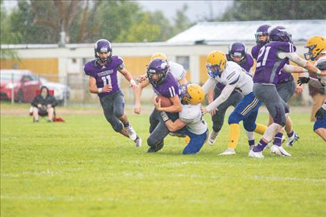 Charlo Viking Braydon Zempel drags a defender for a few extra yards.