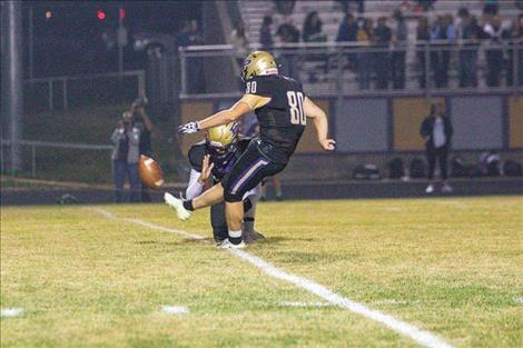 Polson Pirate kicker Nelson Kaden boots the ball through the uprights for an extra point.
