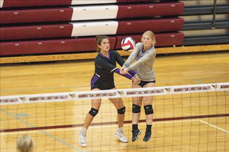 The Charlo Lady Vikings use teamwork to get the ball over the net.