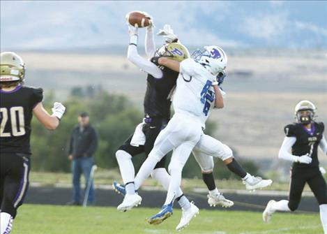 Polson Pirate wide receiver Colton Graham snags a pass over Wildcat defenders.