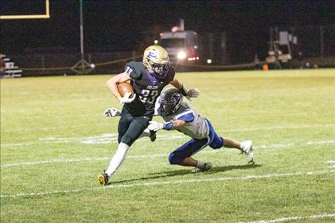 Polson Pirate running back Keyen Nash slips past a defender for a first down.