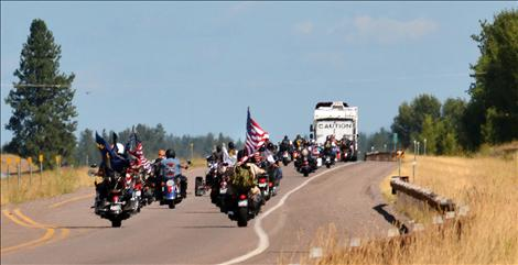 The wall headed north on Highway 93 toward Whitefish, surrounded by motorcyclists.