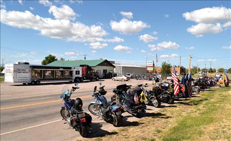 Motorcycles line Round Butte Road by the Ronan VFW.
