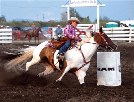 Donna Small and her big paint horse Boogie turn into a barrel at the Flathead River Rodeo, an INFR Tour rodeo. The rodeo drew cowgirls and cowboys from around the nation.