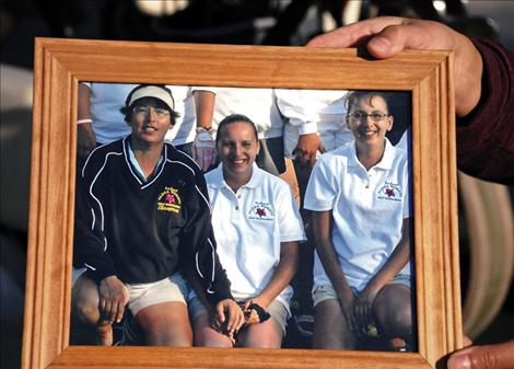 A photo shows Susie and her daughters at a golf tournament soon after Mary Ann's, center, baby was born.