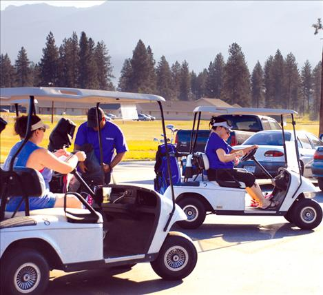 Susie's teams pull out of the parking lot at the Silver Fox Golf Course.
