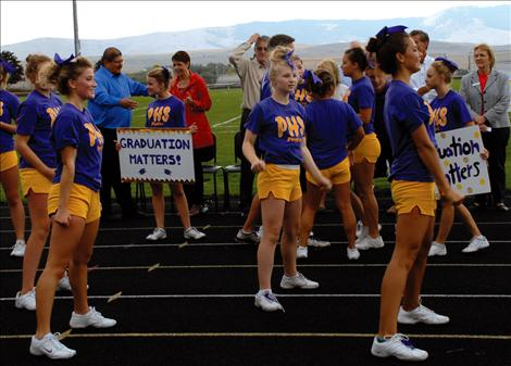 Polson cheerleaders are out in force in purple and gold for the Graduation Matters Kickoff.