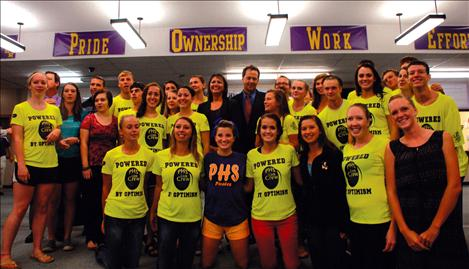 The PHS Link crew, in neon yellow shirts, stand with Governor Steve Bullock and Superintendent Denise Juneau.