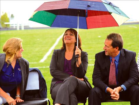 Dr. Kelly Bagnell, left, Superintendent of Public Instruction Denise Juneau and Governor Steve Bullock brave  the rain at  the Graduation Matters Kickoff at  Polson High School.