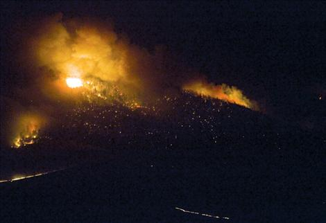 Flames engulf the northeast face of Green Mountain and move towards Hot Springs. In less than two hours Tuesday night, Aug. 14, the entire windward mountain face had burned.